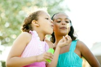 Girls blowing bubbles together