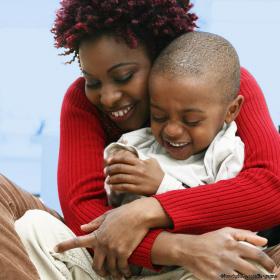 Af_Am-mother-hugging-toddler-son