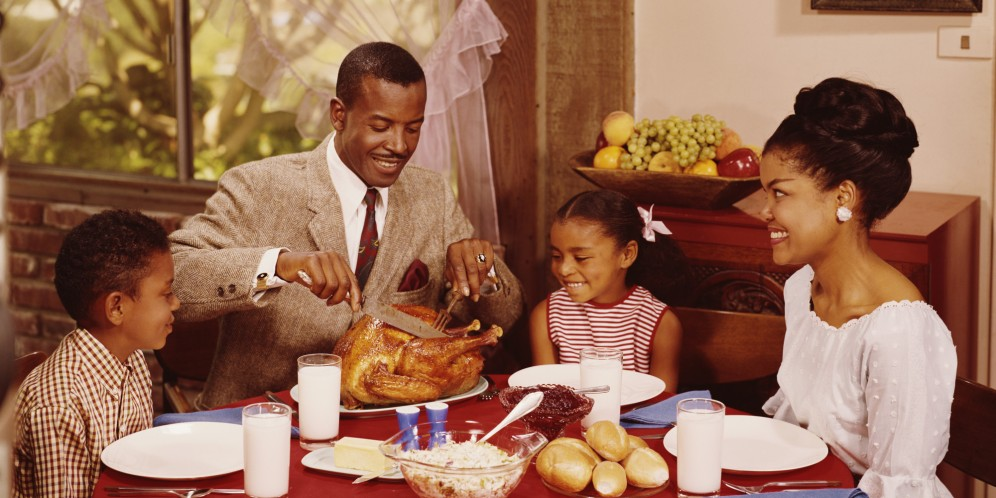 A father carves the roast chicken during a family meal with his wife and children, circa 1970. (Photo by L. Willinger/FPG/Getty Images)