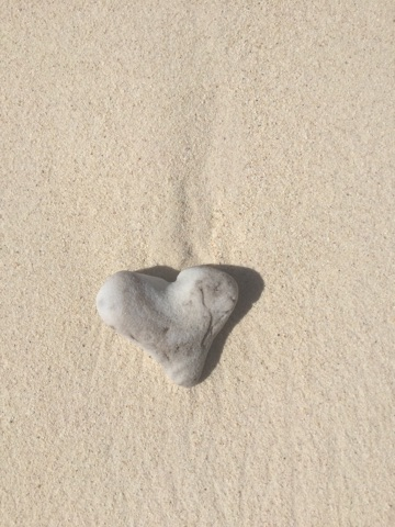 Heart-shaped stone on Seven Mile Beach