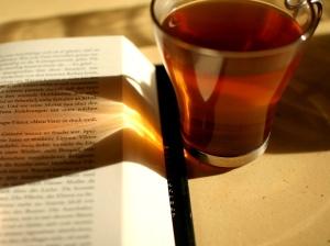 reading_and_drinking_tea_-_sunlight