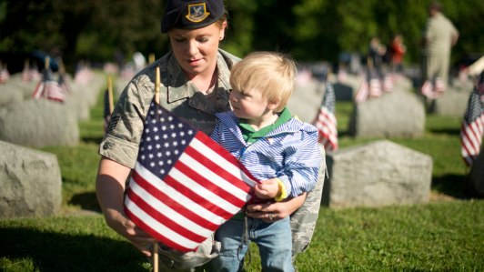 009-airman-son-place-flag-on-veterans-grave