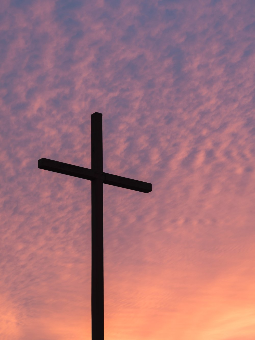 The Cross against a sunset